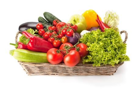 Photo for Fresh and ripe vegetables arranged in a basket isolated on white. Healthy vegan food. - Royalty Free Image