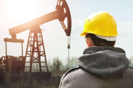 Oil worker in yellow helmet