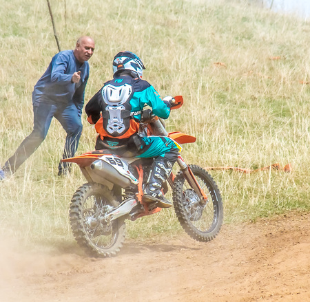 Shymkent, Kazakhstan, April 1, 2018; Open Cup of South Kazakhstan region on the motorcycle cross for the prize Ainabulak. Spectators and participants in the motocross competition.