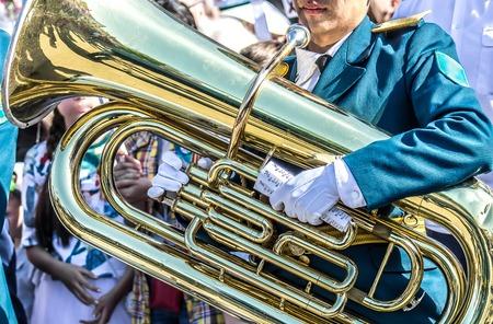 Photo pour A military brass band-Man plays bass - image libre de droit