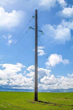 Photo pour Concrete high-voltage support against the sky - image libre de droit