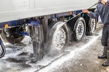 Foto de Washing a truck outdoors. Close-up. Car wash with detergents. - Imagen libre de derechos