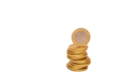 Stack of Euro coins with 1 Euro coin on the top isolated on white background - euro money, savings
