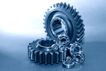 Photo pour Machinery concept. Old rusty gears and ball bearing on gray background - image libre de droit