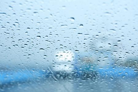 Autumn Rain. Background with raindrops on car window