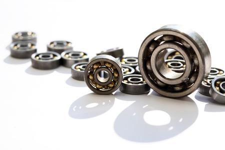 Photo pour Industrial concept. Lot of ball bearings on white background - image libre de droit