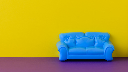 Photo pour Beautiful blue sofa on the purple floor at the yellow wall. A sample of beautiful furniture for the house. Minimalist. - image libre de droit