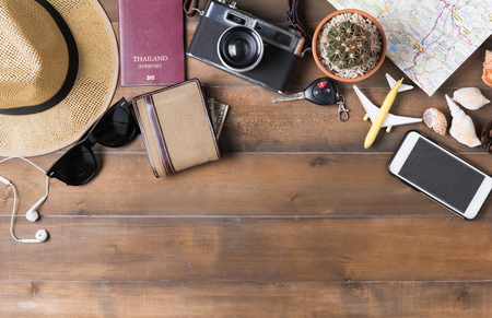 Foto de Travel plan, trip vacation accessories for trip, tourism mockup - Outfit of traveler on wooden background. Flat lay - Imagen libre de derechos