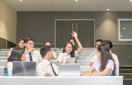 Photo pour Cute teen student Raise  hands to ask teacher in classroom at university, Education concept. - image libre de droit