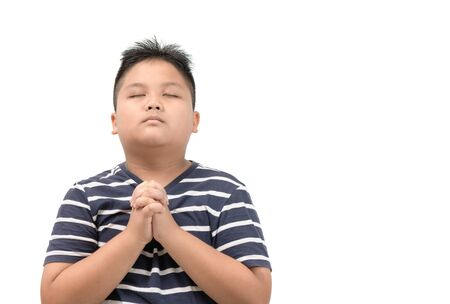 Photo for Asian boy praying isolated on white - Royalty Free Image