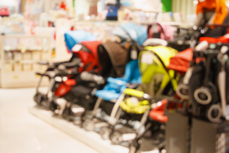 Baby Stroller show in shop department store blur for background