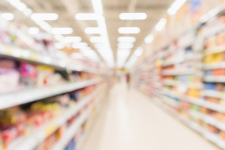 Photo pour Abstract blur supermarket discount store aisle and product shelves interior defocused background - image libre de droit