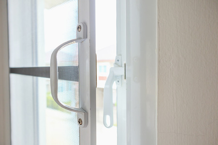Foto de mosquito net wire screen on house window protection against insect - Imagen libre de derechos