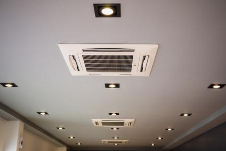 Photo pour Modern ceiling mounted cassette type air conditioning system - image libre de droit