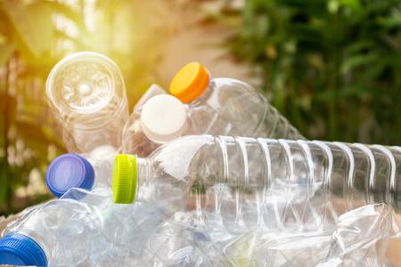 Foto de plastic bottles in brown recycle garbage box - Imagen libre de derechos
