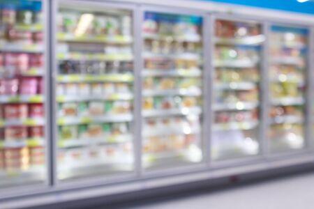 Photo pour supermarket commercial refrigerators freezer showing frozen foods abstract blur background - image libre de droit