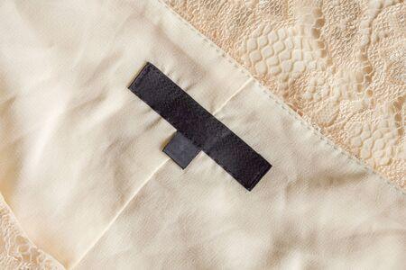 Photo pour Blank black laundry care clothing label on fabric texture - image libre de droit