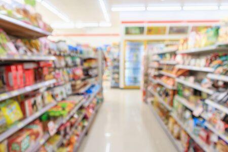 Photo pour Supermarket convenience store aisle shelves interior blur for background - image libre de droit