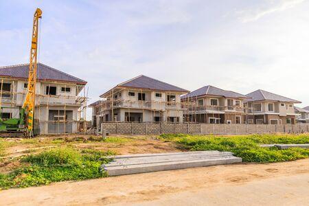 Foto de New house building at residential estate construction site with clouds and blue sky - Imagen libre de derechos