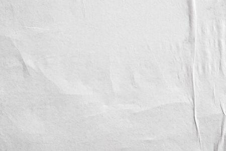 Foto de Blank white crumpled and creased paper poster texture background - Imagen libre de derechos