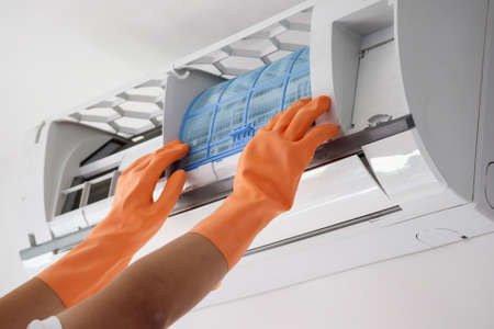 Photo pour Asian man hand hold air conditioner filter cleaning concept - image libre de droit