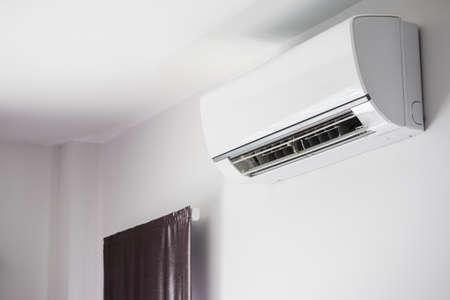 Photo pour Air conditioner on white wall room interior background - image libre de droit