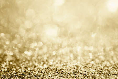 Photo pour Abstract gold glitter sparkle blurred with bokeh background - image libre de droit
