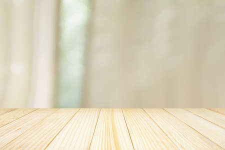 Photo pour Empty wood table top with window curtain abstract blur background for product display - image libre de droit