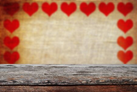 Photo pour Empty old wooden table background with valentines day theme in background - image libre de droit