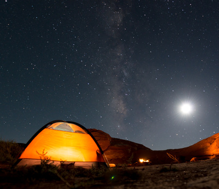 Beautiful Nigt Sky with Milky Way small tent and a camp fire red canyon