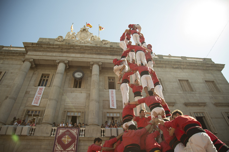 Barcelona, Spain - September 20, 2015: Castelers at La Merce. Human Castle building is a Catalonian tradition and is a UNESCO Masterpiece of the Oral and Intangible Heritage of Humanity