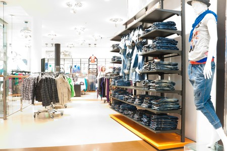 interior of the modern clothes shop. Image overexposed by intent, all customers blured