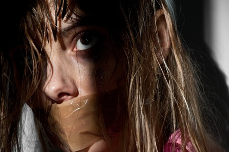 young woman taken hostage with her mouth gagged