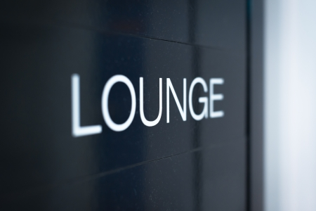Close up view of black sign with big white inscription Lounge  Having rest or comfortable waiting of flight with good service at airport  Business trips and travelling