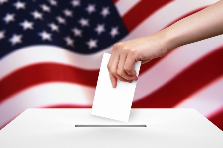 Hand with ballot and box on Flag of USA