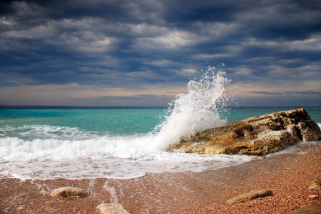 Photo for Wave crash on the stone - Royalty Free Image