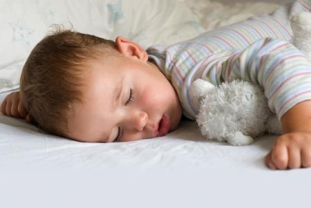 Sweet dream - little boy sleeping with white bear