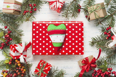 Small beautifully wrapped gift on a white wooden background