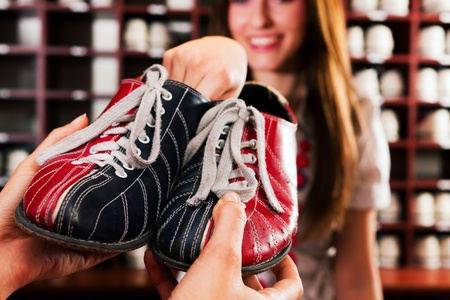 Woman borrow some shoes for bowling in an entertainment club
