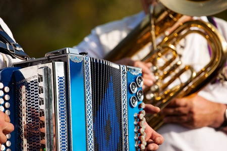 Bavarian traditional band with accordion and tuba playing marching