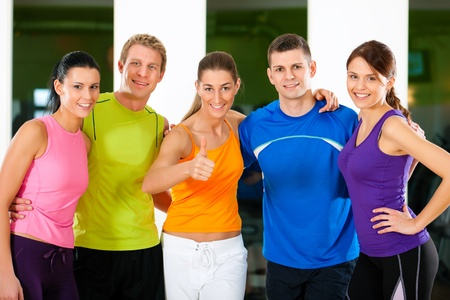 Foto de Group of five people exercising in gym or fitness club  - Imagen libre de derechos