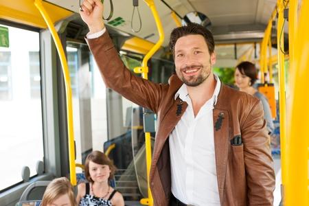 Photo pour Male passenger in a bus; presumably he is heading home - image libre de droit