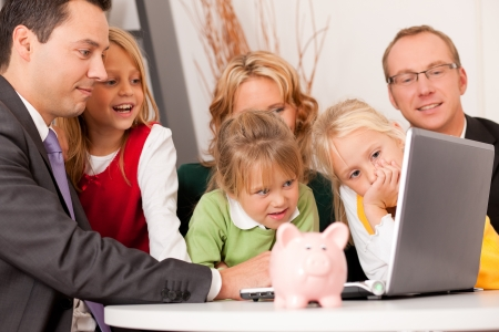 Family with their consultant  assets, money or similar  doing some financial planning - symbolized by a piggy bank in the front