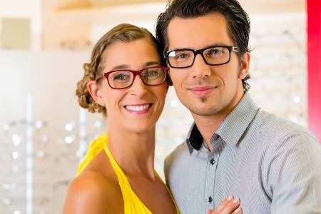 Young couple at optician in the store, they looking for glasses