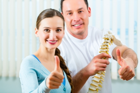Physiotherapist and patient in a practise after a successfully treatment is the diagnosis a clear improvement, thumbs up