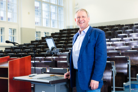 College professor giving lecture and standing at desk