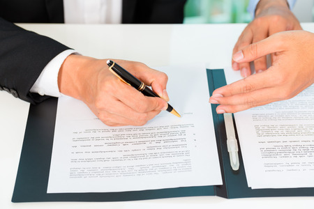 business people sign agreement