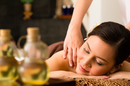 Photo pour Chinese Asian woman in wellness beauty spa having aroma therapy massage with essential oil, looking relaxed - image libre de droit