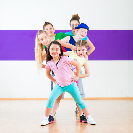 Photo for Children in zumba class dancing modern group choreography - Royalty Free Image