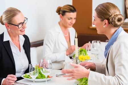 Businesswomen meeting at business dinner or lunch in Restaurant
